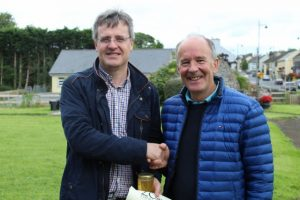 Kieran Moylan receiving 3rd prize from Chairman, Padraig Holmes