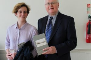 Shane Lynskey (Hon Treasurer, Strokestown Poetry) presenting Valeria Mazzeo (Italy) with an anthology