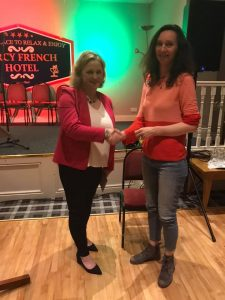 Winner 2019 Roisin Bugler Mountshannon, Co. Clare Rugged 50 Something Male Seeks Lady Companion, being presented with her prize by Maureen Kennelly of Poetry Ireland